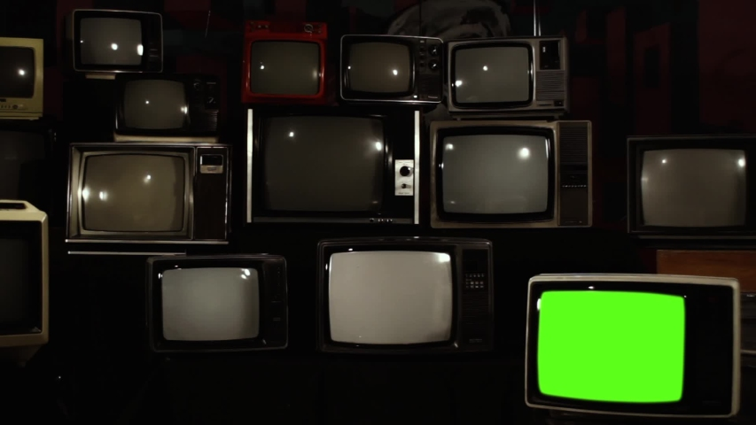 "Pile of Retro TVs from 80s and One TV Turning Off Green Screen.  Zoom Out. You can replace green screen with the footage or picture you want with ""Keying"" effect in After Effects. 
