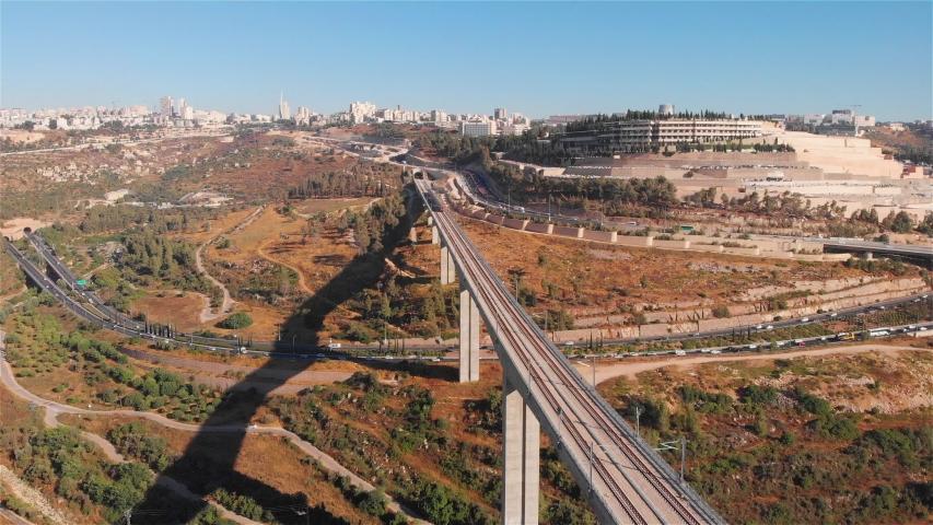Train on large bridge aerial Drone footage of red train over Railway bridge in Jerusalem  | Shutterstock HD Video #1033402211