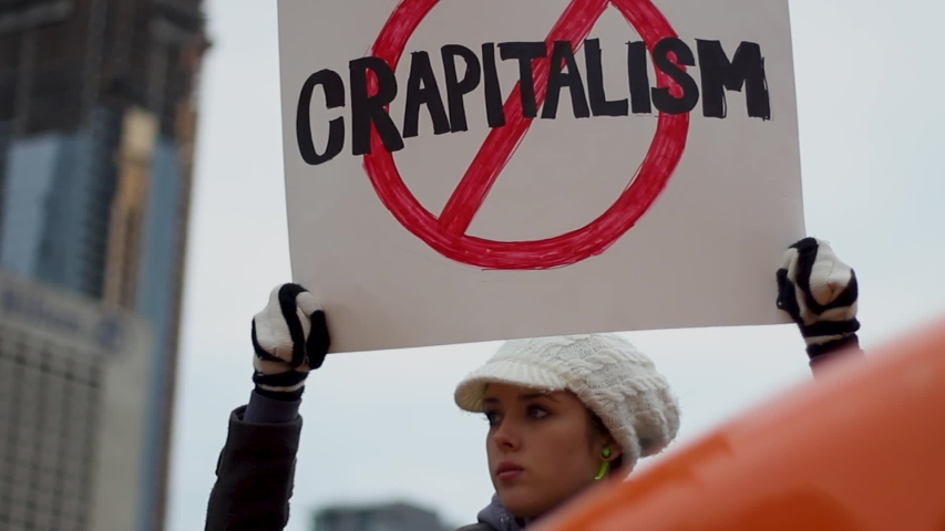Toronto, Canada - 02 01 2019: Woman Holds Crapitalism Banner At Protest Occupy Wallstreet Toronto
