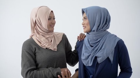 Asian hijab woman hugs her mother sign of love each other at white background