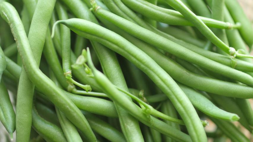Closeup of fresh green asparagus stems. Vegetable dishes. Rotation 360. 4K