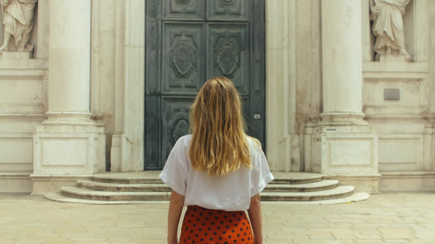 Young woman back looking at the architecture in the old town | Shutterstock HD Video #1033420028