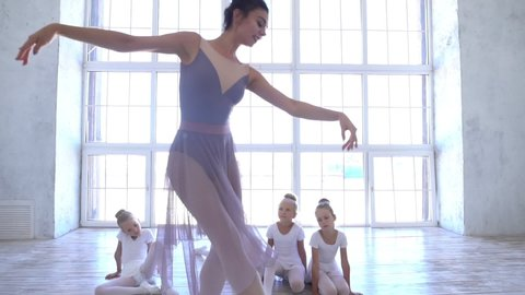Ballet School. Small ballerinas learn to dance. Beautiful view.