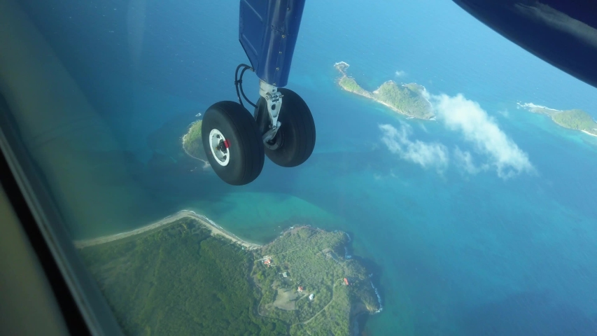 Enjoying the views in a small propeller plane flying over the Caribbean island of Grenada