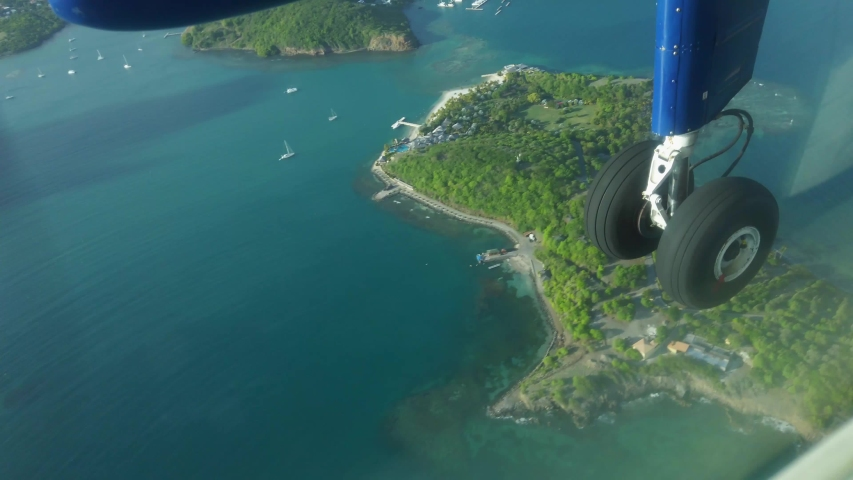 Passenger view of a dhc twin otter flying over the Caribbean island of Grenada