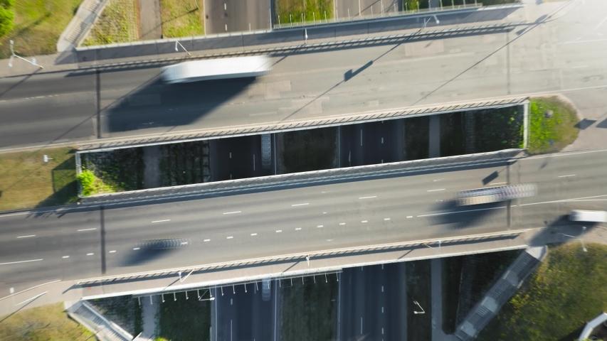 Highway cloverleaf interchange ramps, heavy traffic, aerial hyperlapse   Shutterstock HD Video #1033471229