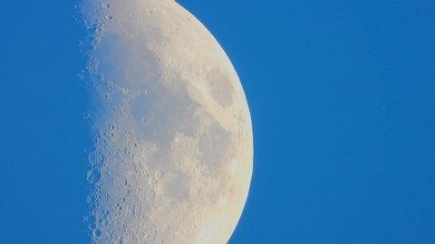 huge moon against a blue sky