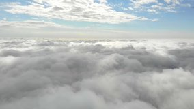 Flying in the clouds flying in the clouds. The clouds are moving on camera. Flying through the cloud