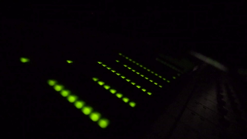 Green light volume equalizer. Recording music and sound.