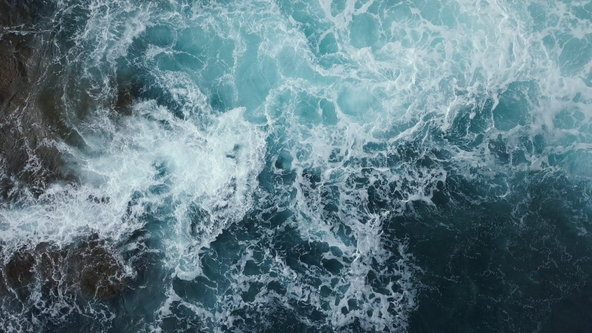 Aerial View Of Sea Waves. Blue ocean background. Flying above water  #1033492298