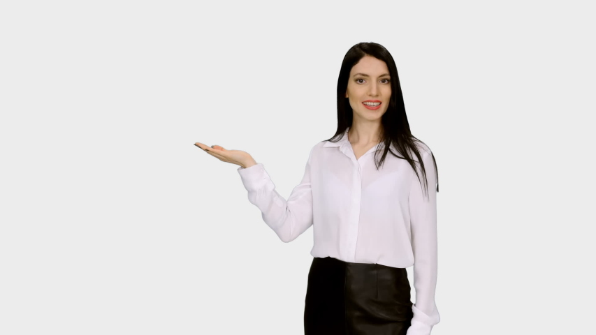 Young charming woman with long hair presenting weather forecast, Front view, Full HD footage isolated on white background with LUMA MATTE | Shutterstock HD Video #1033494218