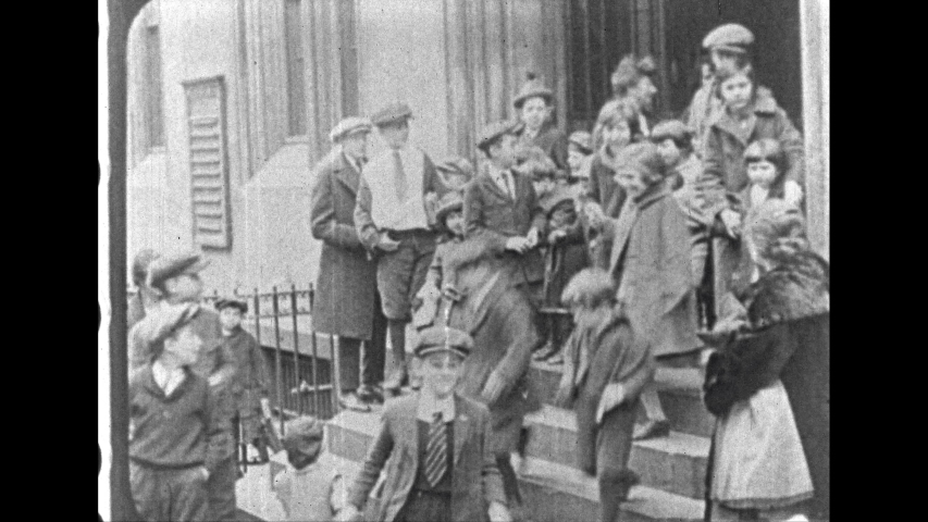 1930s: UNITED STATES: immigrants leave employment office. Shoe shop in New York. Busy street in New York.