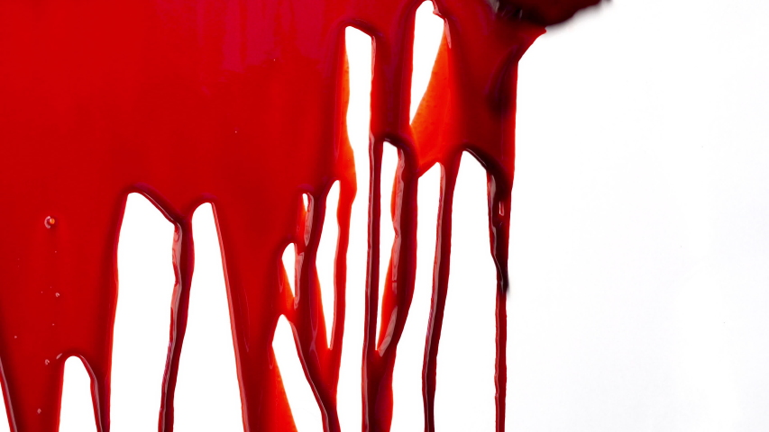 Streaks of blood pouring on a white surface