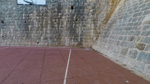 Smooth Pan of Basketball Court and City Walls of Dubrovnik Old Town.