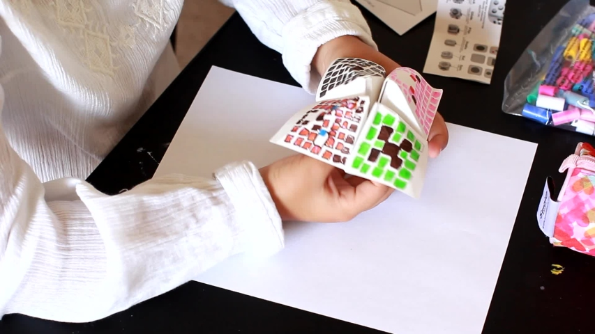 Little Girl Make Origami game for children home activity. Origami is the art of paper folding, which is often associated with Japanese culture.  | Shutterstock HD Video #1033533092