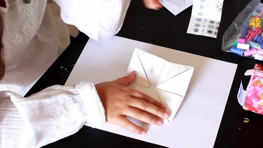 Little Girl Make Origami game for children home activity. Origami is the art of paper folding, which is often associated with Japanese culture.  | Shutterstock HD Video #1033533095