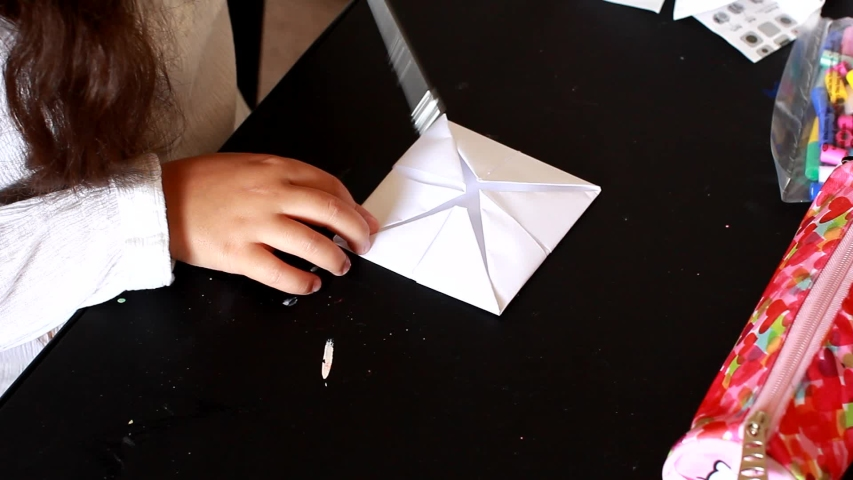 Little Girl Make Origami game for children home activity. Origami is the art of paper folding, which is often associated with Japanese culture.  | Shutterstock HD Video #1033533137