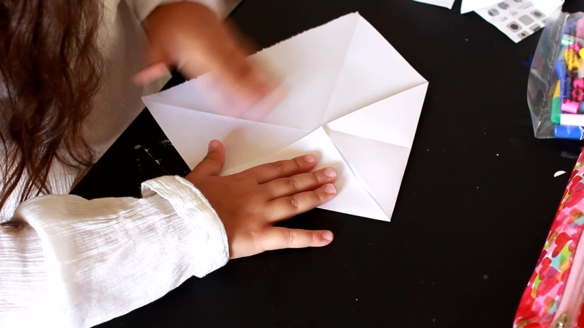 Little Girl Make Origami game for children home activity. Origami is the art of paper folding, which is often associated with Japanese culture.  | Shutterstock HD Video #1033533149