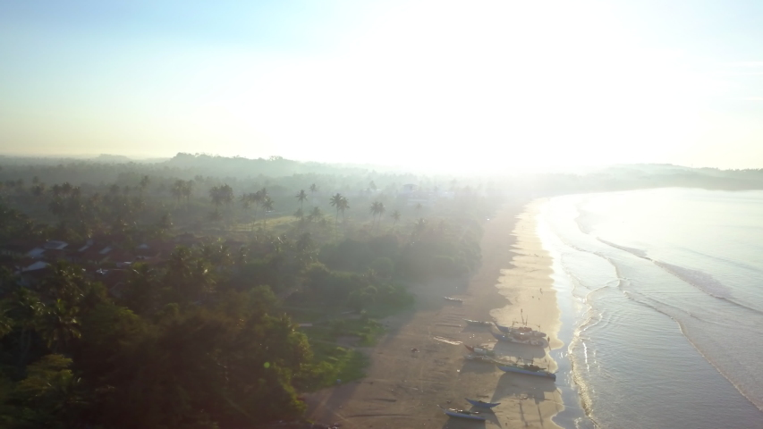 Rotating aerial shot of Weligama Beach, Sri Lanka at sunrise. #1033534556