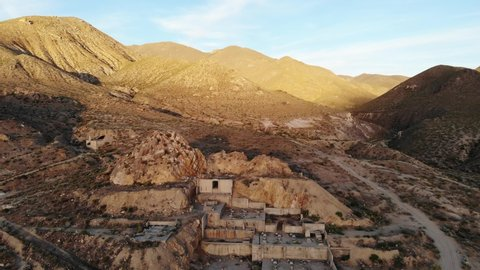 Abandoned Mining Ruins and Mill Site in the Nevada Desert at Sunset - Aerial Drone.