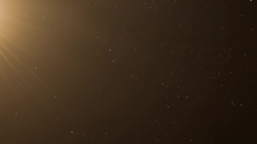 Snowfalling, beautiful Gold Floating Dust Particles with Flare on Black Background   Shutterstock HD Video #1033537157