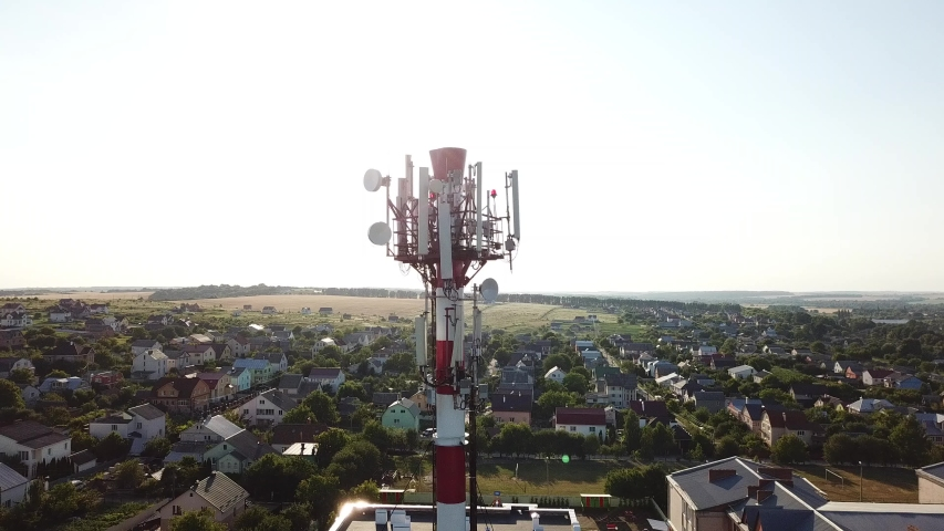 Telecommunication tower of 4G and 5G cellular. Base Station or Base Transceiver Station. Wireless Communication Antenna Transmitter. Telecommunication tower with antennas against blue sky. | Shutterstock HD Video #1033542851
