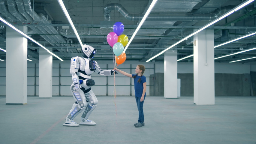 White cyborg giving balloons to a girl, side view. | Shutterstock HD Video #1033569695