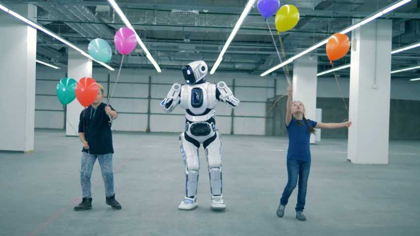 Cyborg and kids dance with balloons, close up. School kid, education, science class concept. | Shutterstock HD Video #1033569704