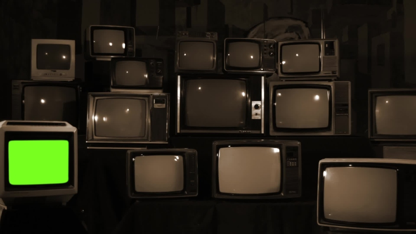 Retro TV Turning On Green Screen over a Pile of Retro TVS from the 80s and 90s. Zoom In Shot.  | Shutterstock HD Video #1033572038