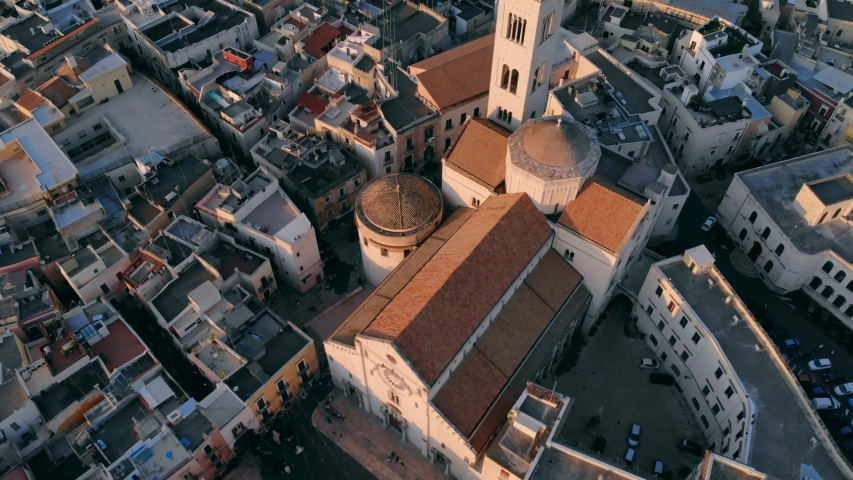 Flying over roof of church in old town of Bari, Italy | Shutterstock HD Video #1033573406