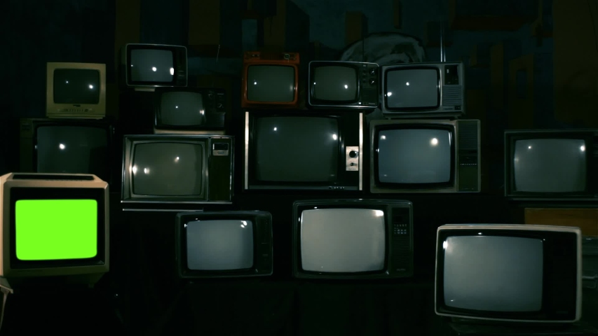 Retro TV Turning On Green Screen over a Pile of Retro TVS from the 80s and 90s. Blue Steel Tone. | Shutterstock HD Video #1033573511