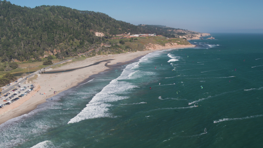 Aerial Drone Shot of a Beach with Kiteboarders and Windsurfers (Waddell Beach, Pacific Coast Highway, California) | Shutterstock HD Video #1033632041