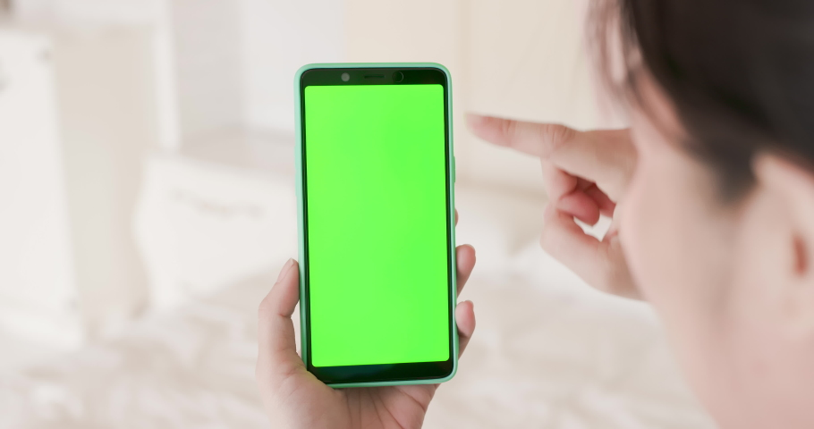 Girl hold green screen mobile phone in hand | Shutterstock HD Video #1033640405