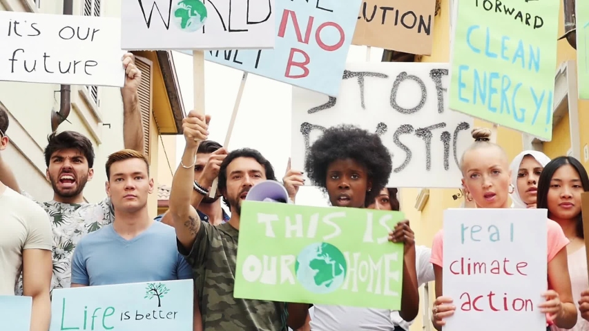 Public demonstration on the street against global warming and pollution. Group of multiethnic people making protest about climate change and plastic problems in the oceans | Shutterstock HD Video #1033661708