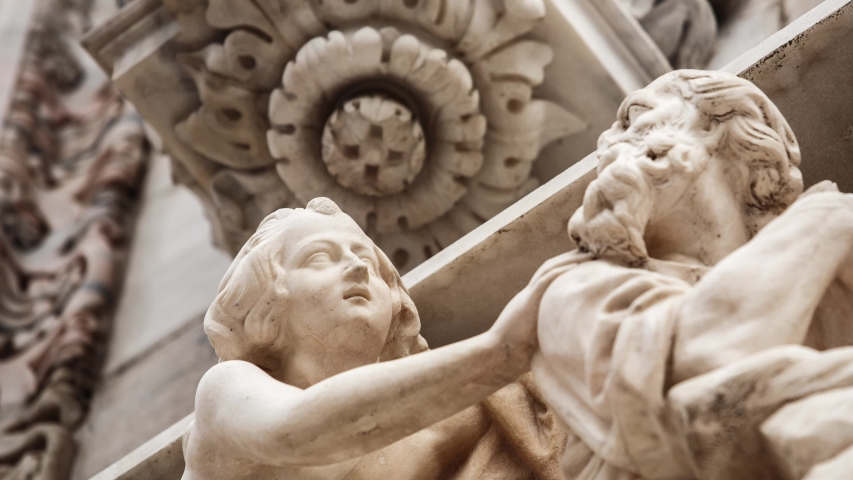 Beautiful Duomo di Milano in close up.White marble stone sculptures and statues in exterior design of ancient catholic church in center of Milan city in Italy.Gothic architecture style in details | Shutterstock HD Video #1033726925