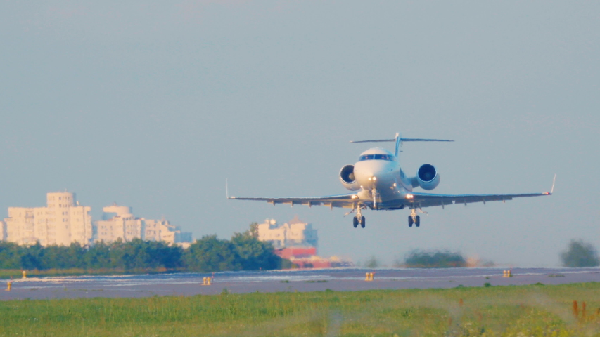 Business jet is taking off at sunset. Private jet, or bizjet takes off at dawn