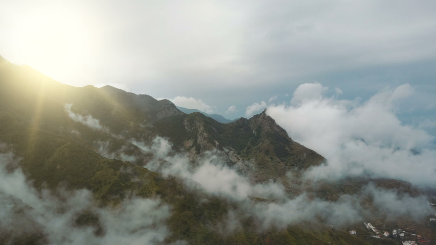 Epic morning Flight over Beautiful mountains and clouds at sunrise on Tenerife, Canary Islands. Water drops fall from the sky. Aerial view of nice rainy morning in Mountains. | Shutterstock HD Video #1033770947