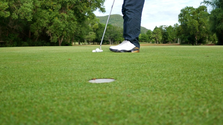 Golfer putting golf ball in the hole, Pattaya Thailand.   Shutterstock HD Video #1033779008
