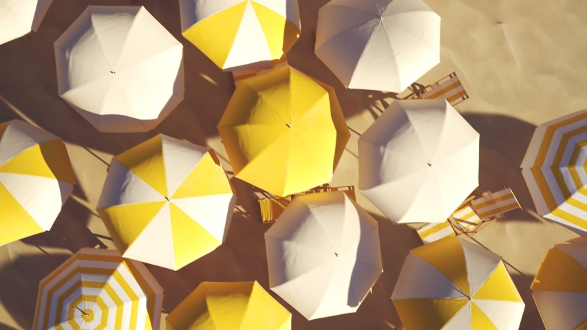 Yellow and white beach umbrellas on the sandy beach. View from the top.  Seamless looping animation with colorful striped umbrellas during a sunny day. Symbol of vacations, relax, summer. 4k