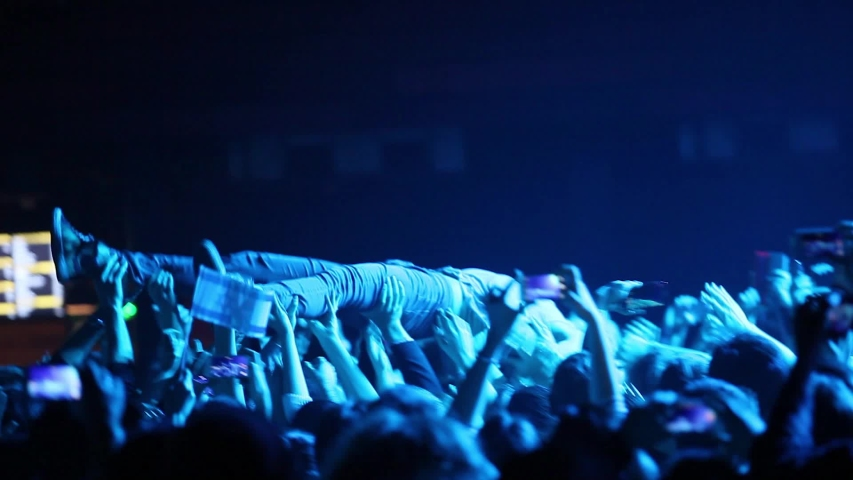 MOSCOW-7 DECEMBER,2014:Matisyahu surfing through the crowd after stage diving on concert in night club