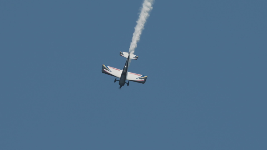 Hay river, northwest territories / Canada - 07 09 2019: Stunt plane dives and rolls | Shutterstock HD Video #1033800992