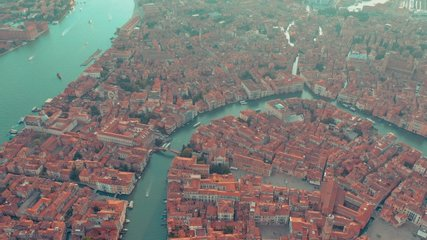 VENICE, ITALY - JUNE, 2019: Aerial drone panorama view of Venice beautiful architecture. Flight over canals and rooftops. Significant tourist sites from above.