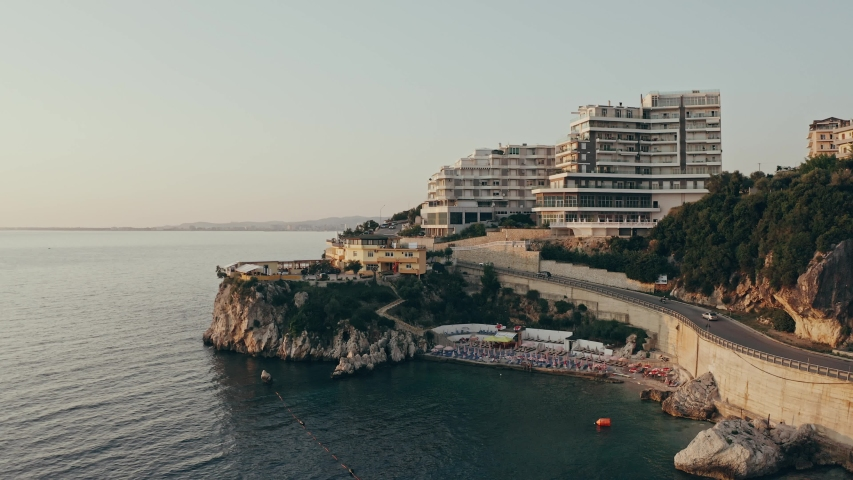 Ascending aerial shot of a coastline hotel revealing a bay 4k   Shutterstock HD Video #1033818848