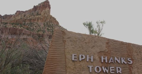 Torrey, Utah / United States - 06 07 2019: Eph Hanks Tower Sign with Eph Hanks in the background