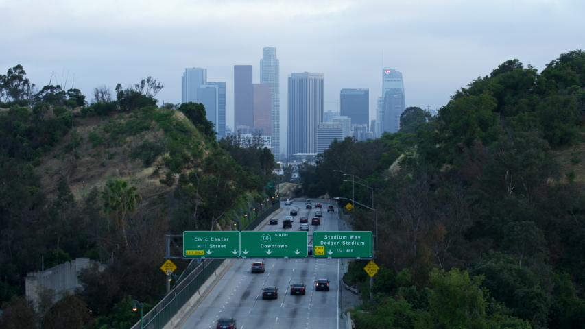 Los Angeles, California / United States - 06 03 2019: Time Lapse of Downtown Los Angeles and Highway 110 from Elysian Park at Dusk With Light Trails