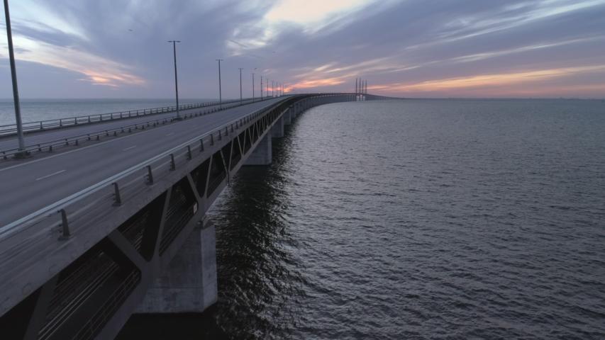 Empty Øresund Bridge, Malmö, Sweden aerial drone view. Quarantined city Copenhagen, Denmark. Empty abandoned bridge, streets and roads during corona virus outbreak Royalty-Free Stock Footage #1033843868