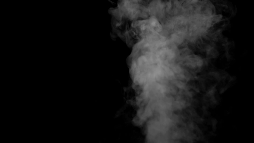 The smoke motion isolated on black background ,slow motion movement #1033847168