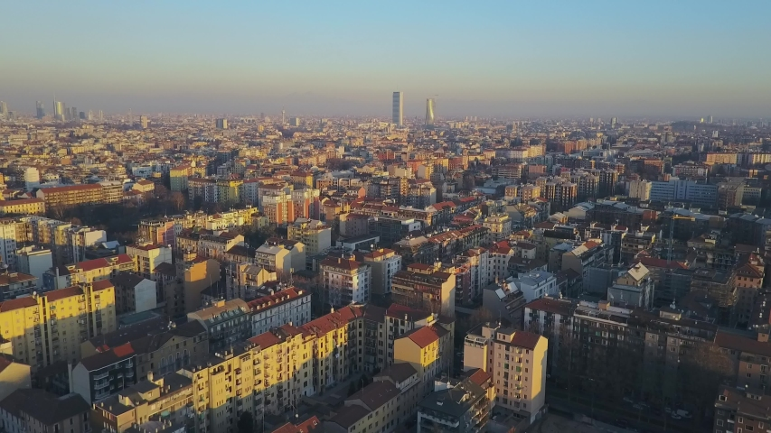 Milan city skyline aerial view at dawn flies backwards. The theatrical performance shot from the Milan cityscape in the fall. Aerial footage. A short flight that shows the city of Milan skyscrapers  | Shutterstock HD Video #1033849175