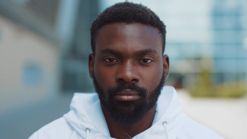 Portrait serious face african american man ooking at camera enjoying in urban city handsome confident lifestyle street urban attractive close up confidence outdoors close up slow motion. The best | Shutterstock HD Video #1033854800