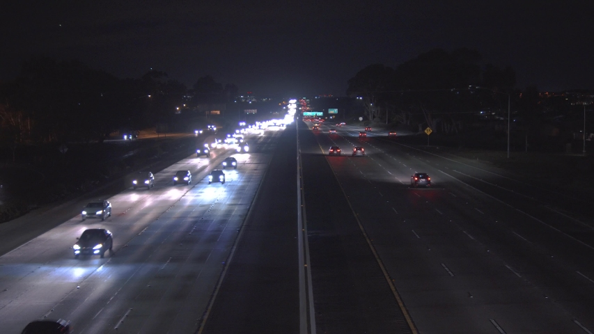 Highway with many cars at night. Heavy traffic | Shutterstock HD Video #1033860116